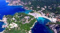Flight aerial Paleokastritsa bay Greece Corfu 4k video. Resort ocean sea coast Stock Footage