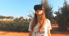 Girl teenager playing with virtual reality headset. Stock Footage