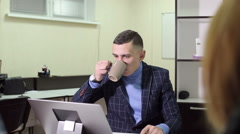 A man drinking and discussing business Stock Footage