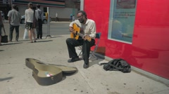 Black Male Street Busking Playing Guitar Pedestrians Walking By Wide Stock Footage
