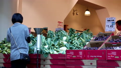 People buying fresh cauliflower inside supermarket with 4k resolution Stock Footage