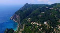 Flight aerial Paleokastritsa bay Greece Corfu 4k video. Ocean sea coast rocky Stock Footage