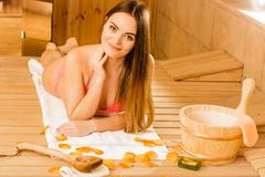 Woman relaxing in sauna. Spa wellbeing. Stock Photos
