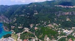 Flight aerial Paleokastritsa bay Greece Corfu 4k video. Village sea mountain Stock Footage