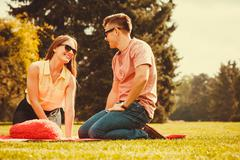 Cheerful affectionate couple on picnic. Stock Photos