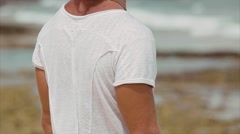 Male surfer on the beach, the wind develops your hair. Stock Footage