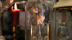 An antique mantle clock, oil lamps, and a crimson candle. Stock Footage
