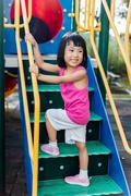 Asian Chinese little girl smiling at playground Stock Photos