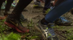 Runners start the race over rough terrain Stock Footage