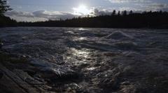Flowing lake water at dusk, foot steps in Stock Footage