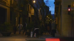 Barcelona Spain Pedestrian street at dusk with traffic passing in the foreground Stock Footage