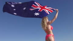 Attractive woman Australian flag at ocean Stock Footage