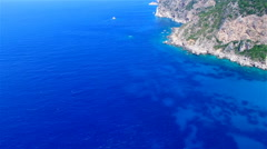 Flight aerial ocean sea water Greece Corfu rocky mountain coast cliff HD video Stock Footage