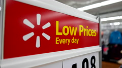Motion of low prices every day sign on woman clothes section Stock Footage