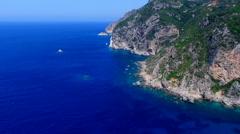 Flight aerial ocean sea water Greece Corfu rocky mountain coast cliff HD video Stock Footage