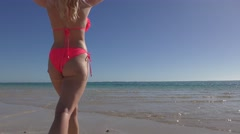 Happy woman running with Australian flag at beach Stock Footage