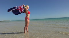 Relaxed woman Australian flag at beach Stock Footage