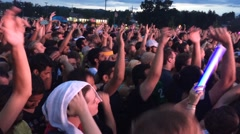 Overhead shot young adults jumping and dancing at concert Stock Footage