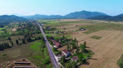 Flying aerial village countryside Greece HD video. Farm agriculture fields road Stock Footage
