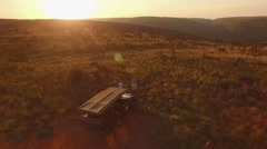 Drone Aerial Of Toyota Land-Cruiser On A Private Game Drive During Sun Set (V2) Stock Footage