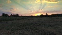 View from drone of village near forest at sunset Stock Footage