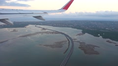Bali Mandara Toll Road, aerial view with the plane wing Stock Footage