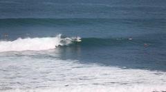The surfers and waves, marine elements Beach, Uluwatu, Bali, Indonesia. Stock Footage