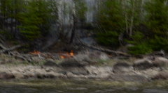Shoreline forest fire from boat Stock Footage