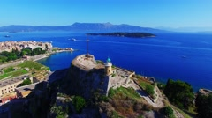 Old Fortress castle Marina harbor Corfu Greece 4k video. Garitsa Bay sea coast Stock Footage