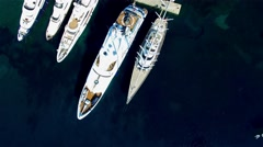 Marina pier harbor yachts boat aerial top view 4k video. Sea ocean transport Stock Footage