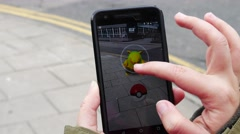 "People playing ""Pokemon GO"" the hit augmented reality smart phone app Stock Footage"