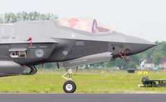 LEEUWARDEN, NETHERLANDS - JUNE 11, 2016: Close-up of the new F-35 at air show Stock Photos
