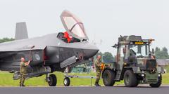 LEEUWARDEN, NETHERLANDS - JUNE 11 2016: F35 Joint Strike Fighter is towed to  Stock Photos