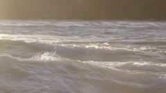 Lake water waves glow in sunlight Stock Footage