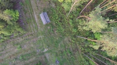 Top view of house on roof edge of forest. Aerial Video Stock Footage