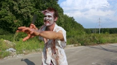 Horrible zombie, walking along the road for the victim Stock Footage