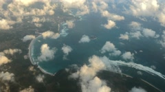 Lombok coast from plane, sandy bay with waves and small clouds Stock Footage