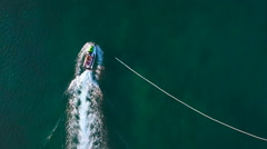 Aerial of scooter accelerating on sea 4K Stock Footage