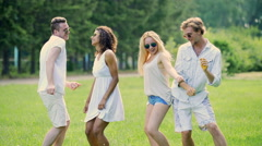 Two cute couples hanging out at open-air festival, dancing to music, having fun Stock Footage