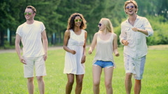 Four young people dancing at open-air party, enjoying life, active lifestyle Stock Footage