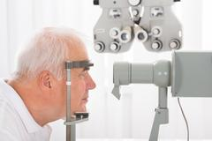 Close-up Of Senior Man Checking Eyesight In Clinic Stock Photos