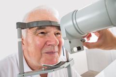 Close-up Of Senior Man Checking Eyesight In Clinic Stock Photos
