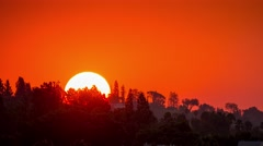 Sunrise sun orange sky rising above Hollywood Hills Los Angeles California Stock Footage