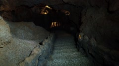 Cavern catacomb stairs  - caves with stalactites Stock Footage