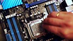 Technitian applies thermal paste on CPU. 3840x2160 Stock Footage