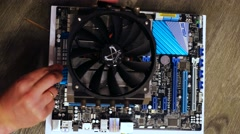 Setting up cooler to CPU processor at motherboard. 3840x2160 Stock Footage