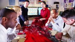 4K Team of fashion designers or retailers in a business meeting Stock Footage