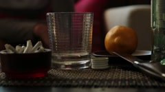 Sad lonely woman drinks alcohol in the dark. Glass in sharp focus. female Stock Footage
