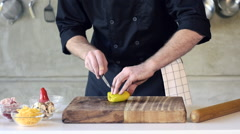 Restuarant hotel private chef cutting mushrooms on board Stock Footage