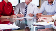 4K Business team in meeting, hands reach across the table to shake hands Stock Footage